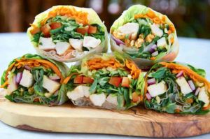 Healthy vegetable wraps carrots, greens chicken