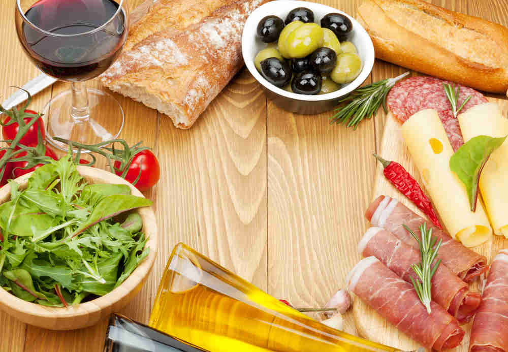 cheese, prosciutto, bread, olives, vegetables