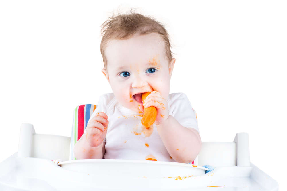 toddler eating solid food